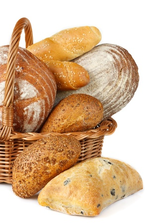 Warm tasty bread in a wicker basket on a white. photo