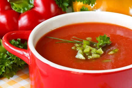 tomato sauce: Tasty tomato soup with green paprika and herbs. Stock Photo
