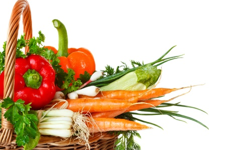 Wicker basket with fresh garden vegetables. photo