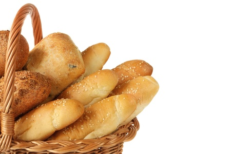 french bread rolls: Fresh homemade bread in a wicker basket. Stock Photo
