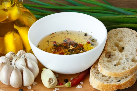 dips: Crusty bread ciabatta and bowl of olive oil with spices. Stock Photo
