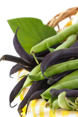 french bean: Purple and green french beans in a basket.