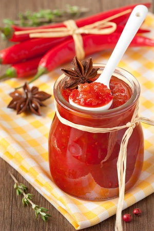 sause: Homemade chili confiture with anise and thyme in a jar.