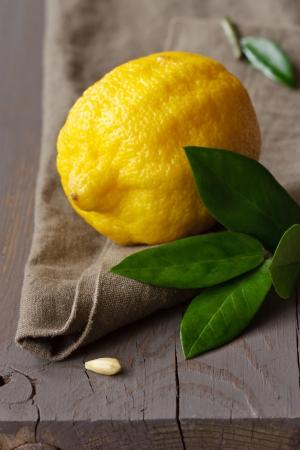 Fresh lemon with leaves on a linen napkin. photo
