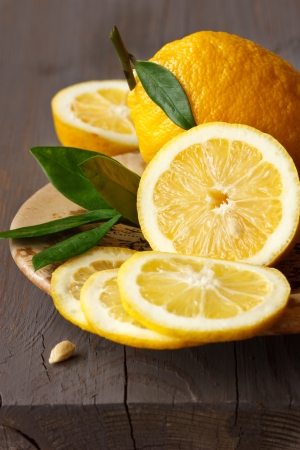Fresh juicy sliced lemon on a ceramic plate. photo