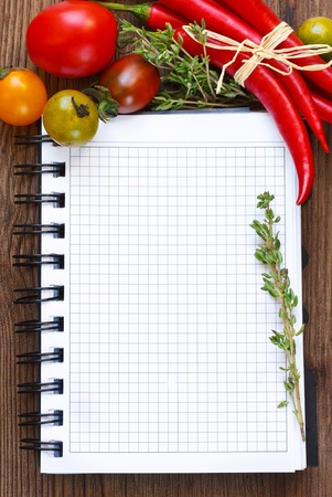 recipe book: Vegetable notebook on an old wooden board