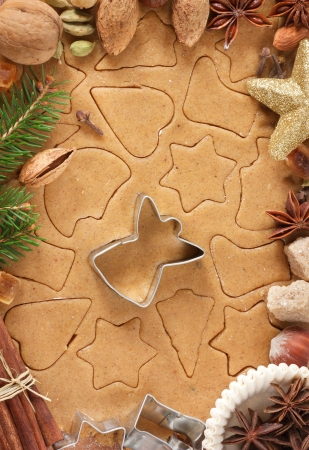 Homemade christmas cookies, spices and angel cutter  photo