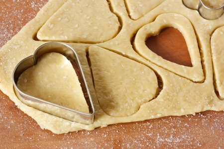 cookie cutter: Heart cookies cutter on raw cookie dough.