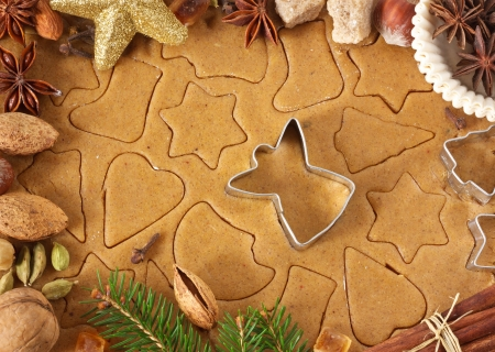 Homemade christmas cookies, angel cutter and spices. photo
