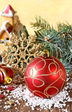 Christmas composition with red bauble and golden snowflake. photo