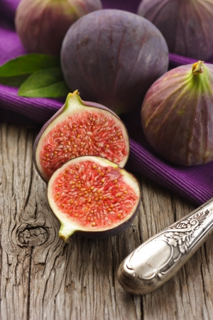 purple fig: Sweet figs and knife on an old wooden table.