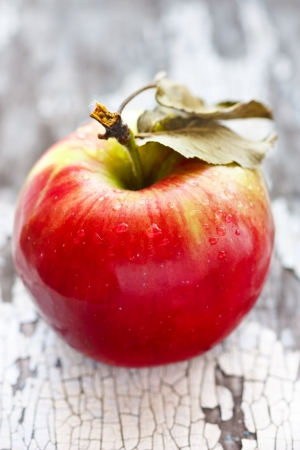 cracky: Ripe red apple on an old cracky wooden board.