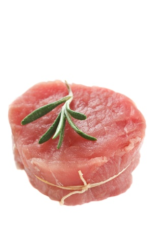 pork meat: Fresh meat with rosemary on a white background. Stock Photo