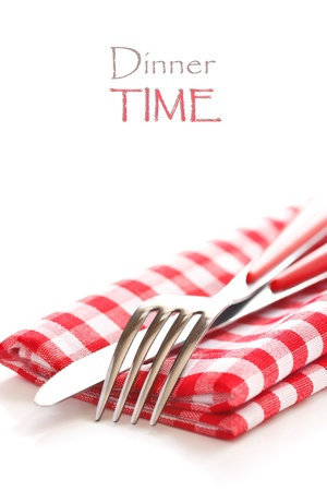 red tablecloth: Fork and knife on a red and white napkin with copy space. Stock Photo
