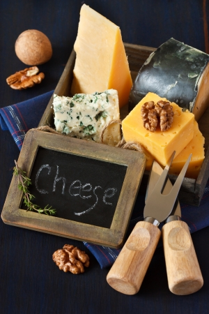 Various types of cheese composition and walnuts with vintage chalk blackboard tag  photo