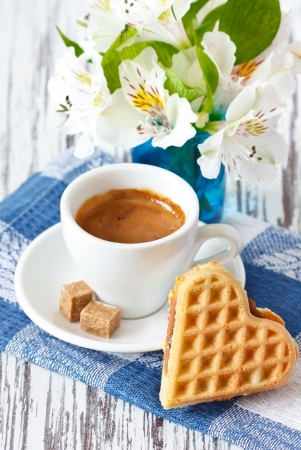 Sweet heart waffle and cup of coffee with brown sugar  photo