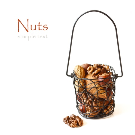 Mix of nuts in a basket on a white background  Stock Photo - 18111494