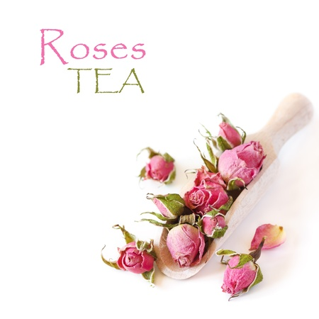 Roses flowers tea in a wooden scoop on a white background  Reklamní fotografie