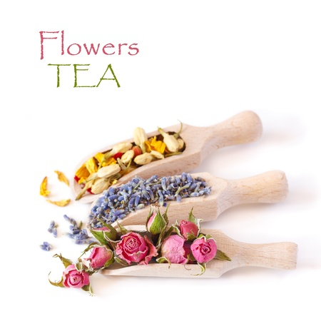 dries: Flowers tea collection in a wooden scoops on a white background  Stock Photo