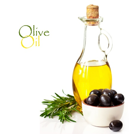 cooking oil: Bottle of olive oil and black olives on a white