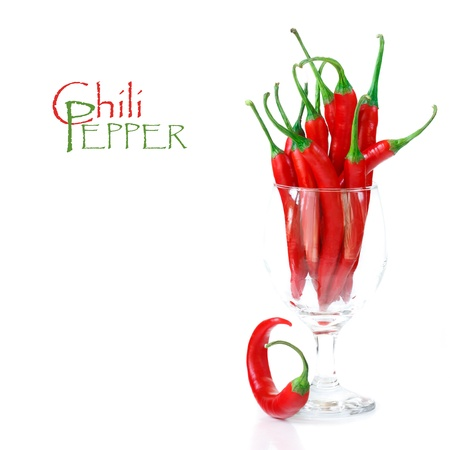 red jalapeno: Hot chili peppers in a wine glass on a white