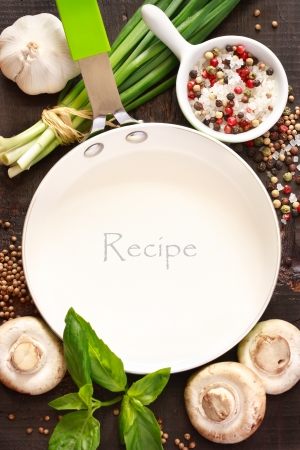 recipe: White frying pan with copy space for note or recipe surrounded by food ingredients