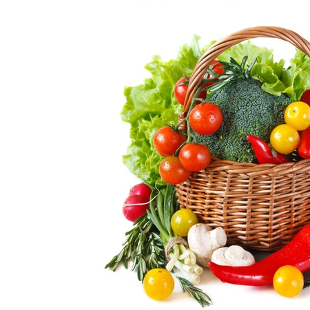 Fresh ripe vegetables with water drops in a basket  photo