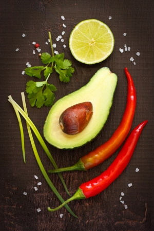 ingredient: Ingredients for guacamole dip on a dark background  Stock Photo