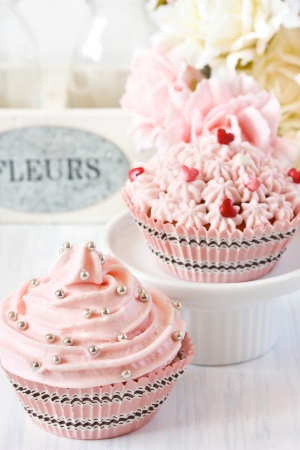 Pink cupcakes and roses for party  photo