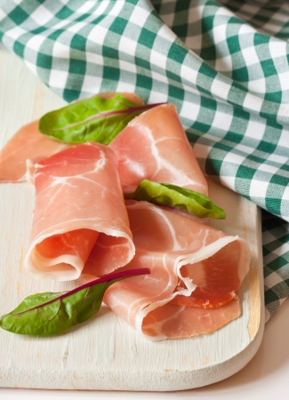 Sliced ham on a white cutting board  photo