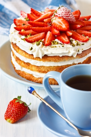 Strawberry cake with whipped cream and pistachios. photo