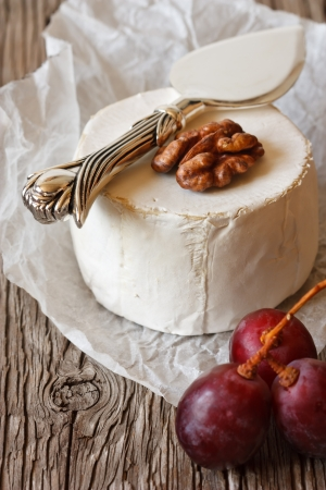 Camembert cheese with walnut and grape  photo