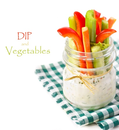 Fresh vegetables with spicy yogurt dip in a glass jar  Stockfoto