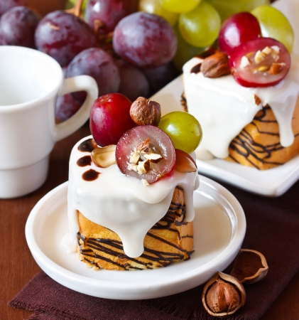 Nut cake decorated with grape and chocolate. photo