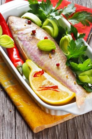 goatfish: Fresh goatfish with lemon, leek and spices. Stock Photo