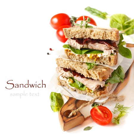 turkey bacon: Sandwiches with meet, vegetables and mustard on crusty fresh sliced rye bread  Stock Photo