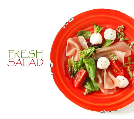 Delicious salad witn ham and mozzarella cheese. photo