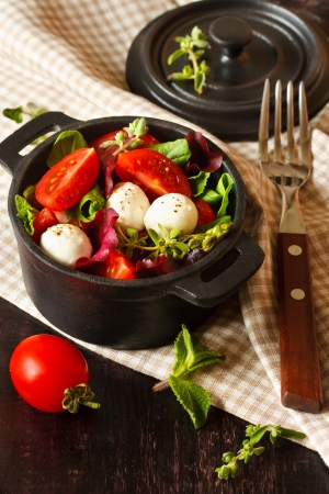 Fresh salad with mozzarella cheese and vegetables. photo