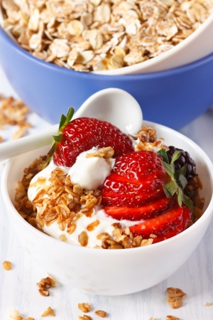 Homemade granola with yogurt and berries for breakfast. Healthy food.