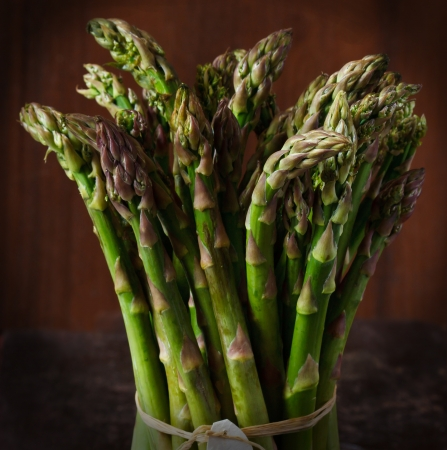 spears: Bundle of fresh green asparagus on a wooden background  Stock Photo