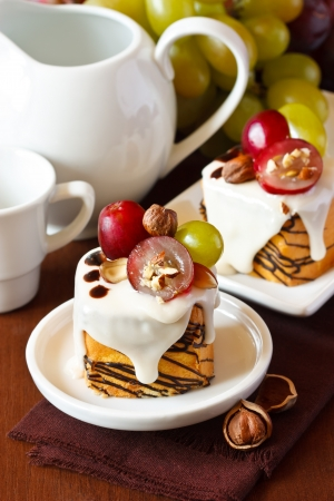 Nut cake decorated with grape and chocolate  photo