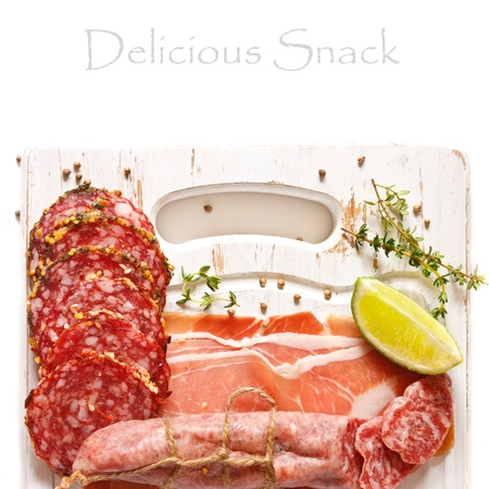 Delicious meat snack on an old cutting board  photo