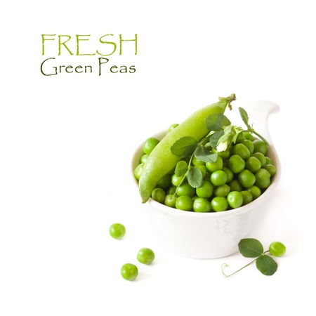 Fresh kitchen garden green peas with pod and flower in a white bowl  photo