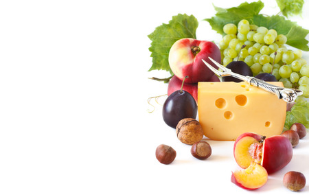 Cheese and fruit on a white background. photo