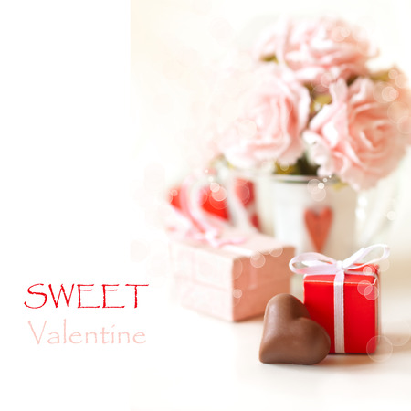 pink hearts: Sweet heart chocolate and roses on a white background. Stock Photo