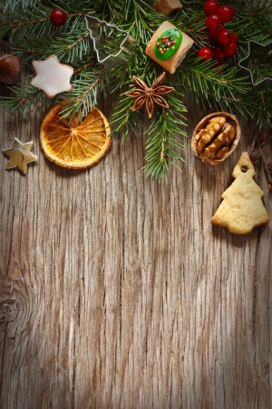 Christmas decoration with cookies and spices on an old wooden background.