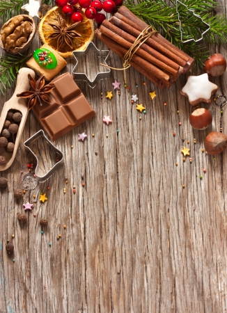 Christmas decoration with cookies and spices on an old wooden background. photo