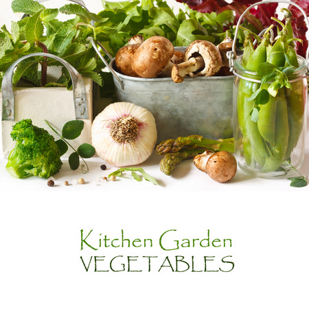 Fresh kitchen garden vegetables and aromatic herbs.
