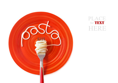 Italian pasta spaghetti with fork on a red plate  photo