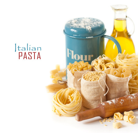 Assortment of pasta and ingredients on a white background. Stock Photo